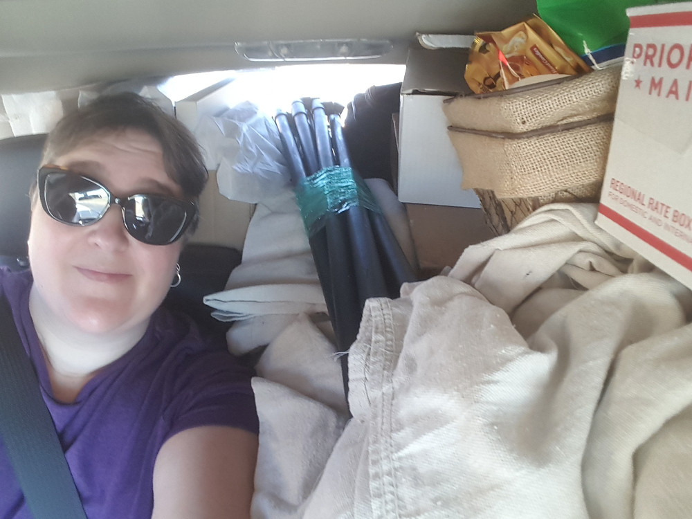 Smooshed in the back seat with all my supplies!
