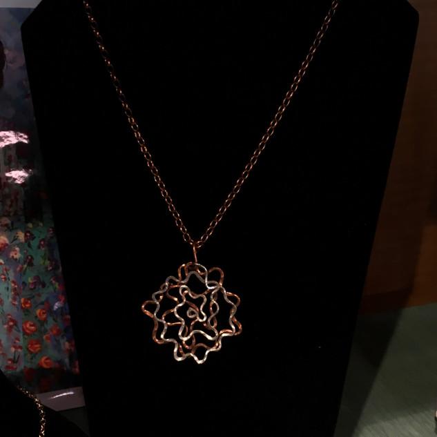 Hammered metal jewelry by Lynn Schmitt