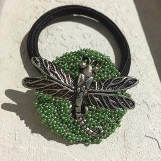Henwak Gallery's hair candy display by Pamela Henry. Dragonfly hair tie.