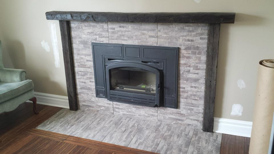 Fireplace installation, new mantle and retiliing walls and floor