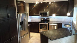 Custom kitchen- granite, tiles and cabinetry