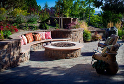 exterior-dazzling-round-fire-pit-connected-by-curved-stone-fire-pit-seating-with