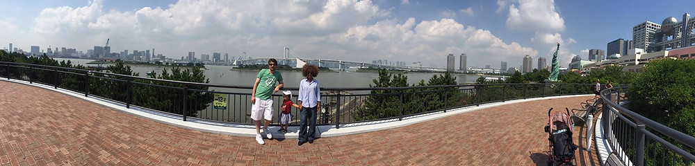 At Odaiba with the Rainbow bridge behind us and the statue of Liberty on the right.