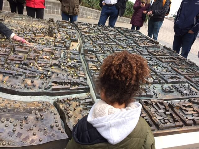 """Loreva @ the main city square of Ban Josip Jelačić and Kaptol.She is looking at the Bronze scale model of the city of Zagreb.It is 3.65 meter long and 3.55 meter wide .It is called """"Zagreb Welcomes You"""" and, it displays all of the most important historic landmarks and tourist attractions in the city centre."""