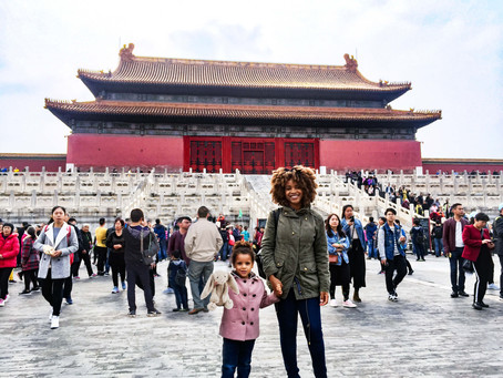 With kids at the Forbidden City in Beijing