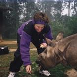 Carol feeding Baby India Rhino in Nepal's Chitwan Reserve