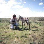 Carol with Baby Zebra, Maasai Mara, Kenya