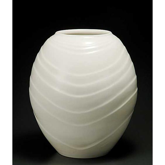 白釉彫紋壺