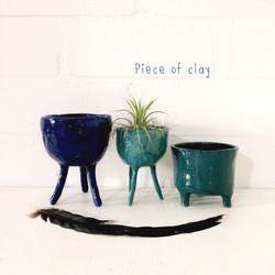 planters in blauw groen