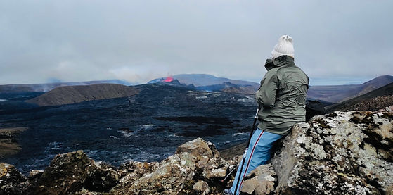 A person overlooking the crater at Fagradalsfjall volcano with 2Go Iceland Travel Tours.jp
