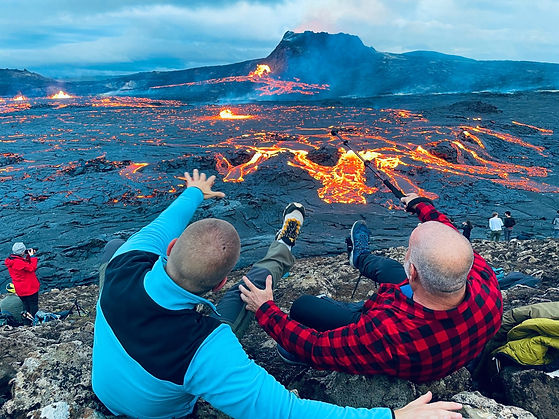 Customers with the lava behind at Fagradalsfjall Volcano, with 2Go Iceland tours.jpg
