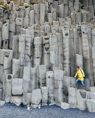 Female traveler walking on rocky formations at Reynisfjara Beach, Vik, Iceland_edited.jpg