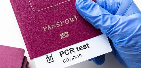COVID-19 and travel concept, mark of coronavirus PCR testing in tourist passport. Diagnost