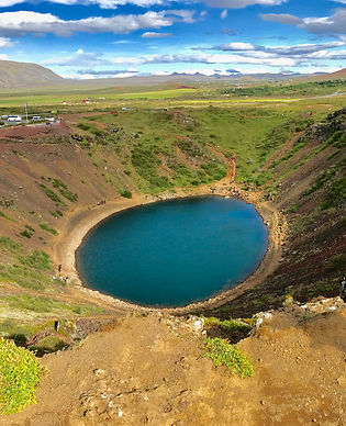 A girl posing over the volcanic crater Kerid in Iceland.jpeg
