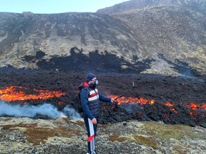 A person taking a selfie with the lava behind at Fagradalsfjall volcano_0.5x.jpg