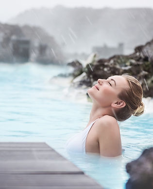 Woman enjoying natural spa, Blue Lagoon is a geothermal spa in southwestern Iceland, is lo