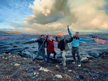 Customers with the lava behind at Fagradalsfjall Volcano, with 2Go Iceland tours B.jpg