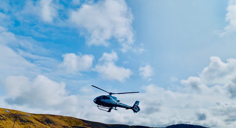 Helicopter landing after the volcano eru