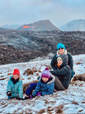 A family seating near the lava at Fagradalsfjall
