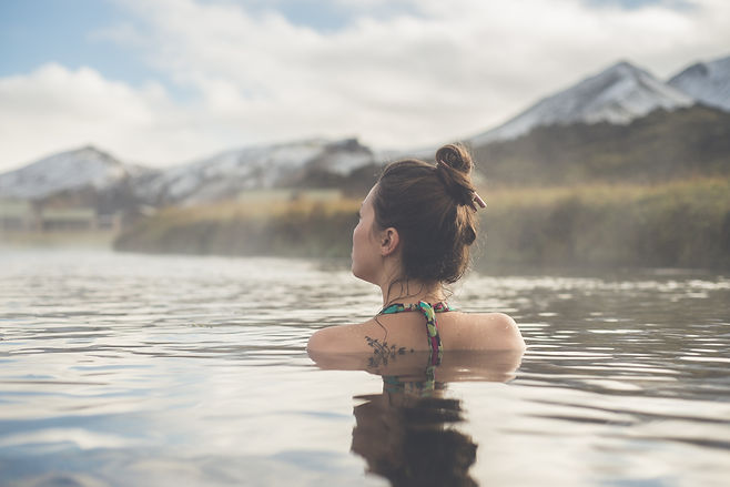 2Go Iceland   Facts About Iceland   Girl in a hot spring in Iceland Landman