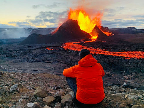 Man looking at the volcano Fagradalsfjall in a sunset.jpg