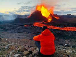 Man looking at the volcano Fagradalsfjal