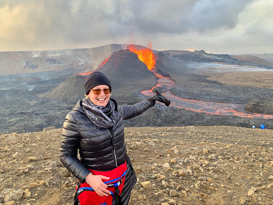 A woman smiling and happy at the volcano