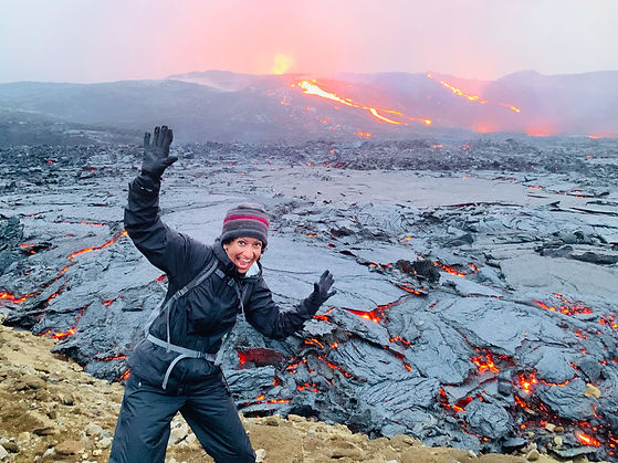 Happy woman near the Lava Field at Fagradalsfjall during the volcano tour with 2Go Iceland