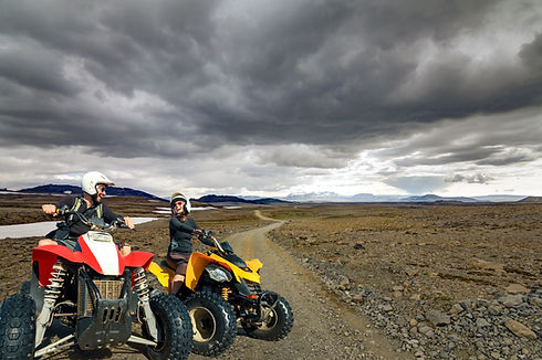 Laughing young couple ATV quad bikers sm