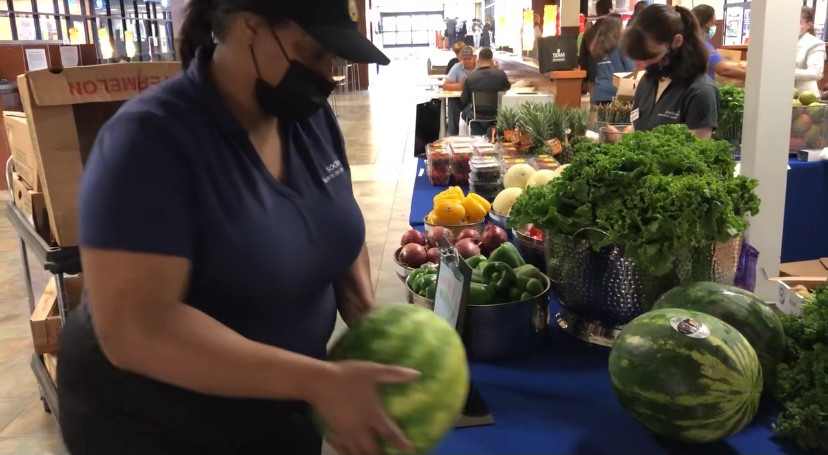 woman placing watermelon on table