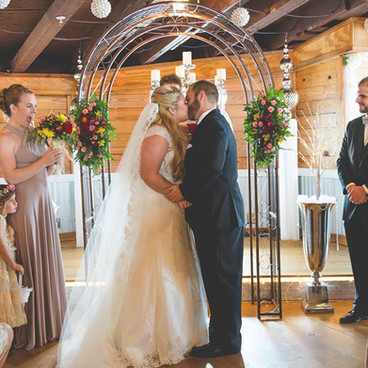 indoor wedding with stage and arch