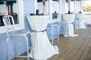 Wrap-around deck with bistro tables
