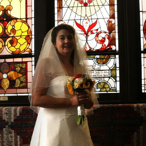 a bride poses before her ceremony