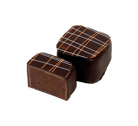 Coppeneur, Noir Orange-Ingwer, kandierte Orangen- und Ingwerstücke eingefangen in eine aromatische Chocoladen-Ganache.