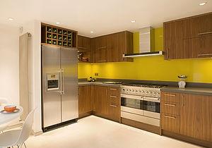modern kitchen with yellow glass splashbacks in toughened glass