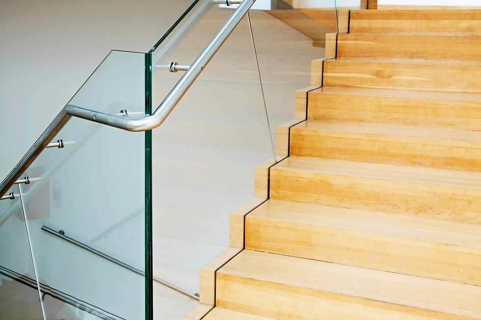 staircase with glass balustrade and wooden steps