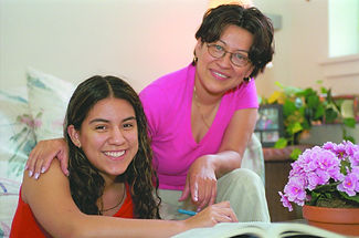 Hispanic older child with mother doing h