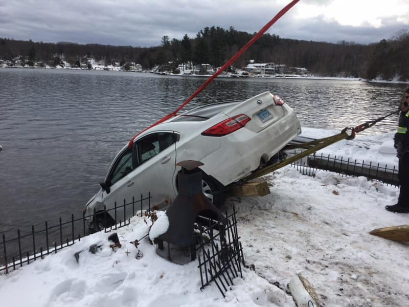 Car slid off of road, went into lake