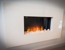 Relaxing holiday by the fire at By the Harbour apartment, West Bay self catering, Dorset