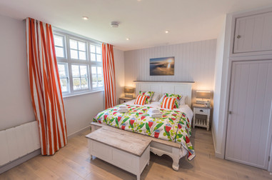 Bedroom with a view out to the golden cliffs, featured as Broadchurch cliffs