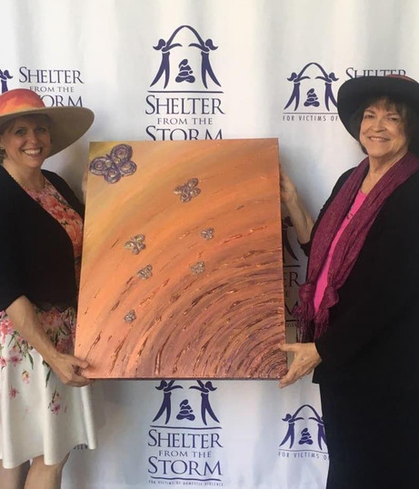 "Lorana's ""Emerging From The Storm"" painting helps Shelter From The Storm"