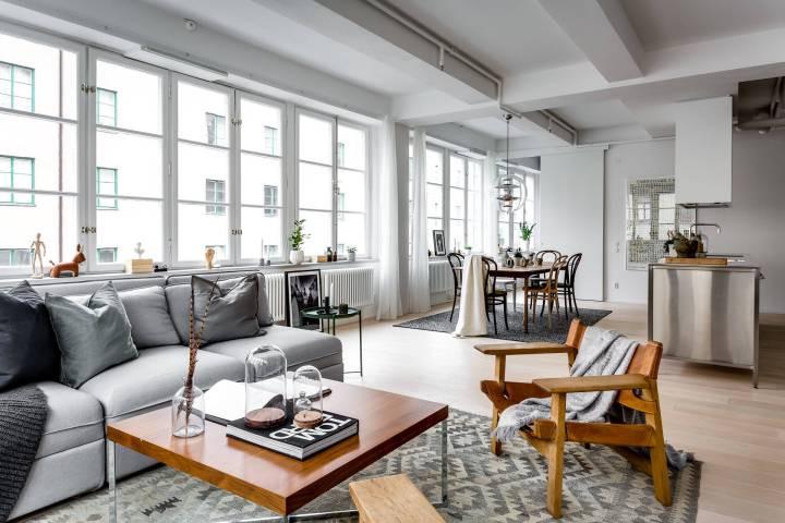 piso en antigua fábrica diseño loft decoración nórdica decoración loft decoración interiores suecos decoración gris madera plantas blog decoración escandinava Apartamento tipo loft con grandes ventanales