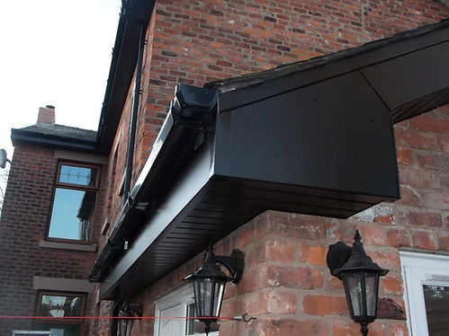 all black upvc gutter, fascia and soffit