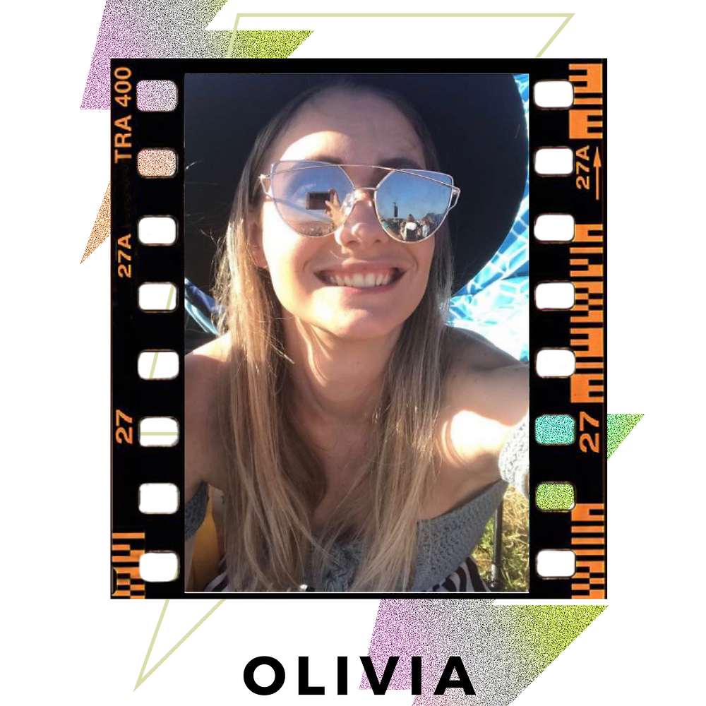 a selfie of Olivia, smiling at  the camera, her long brown hair covering her chest.  She is wearing big sunglasses and a black hat Image is bordered  with black film and decorative/colourful lighting bolds behind image.  Text: Olivia