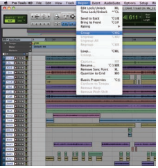 "Figure 3. Selecting all tracks in the Pro Tools Edit window and choosing the ""Group"" function in the Region menu."