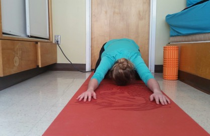 """Child's Pose"", simple, relaxing pose and great for back soreness."