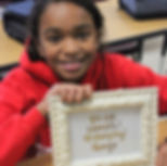 Smiling girl with award