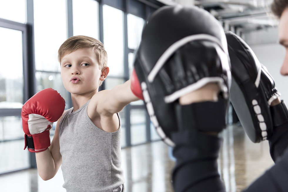 young boy boxer practicing punches with