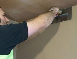 plasterer plastering wall
