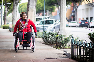 Smiling woman in a wheelchair.